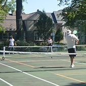 Active older adults playing pickleball