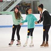 Girls skating at Thornton Park Ice Arena