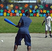 Kids playing mushball at Chelton Park in Shaker Heights, Ohio