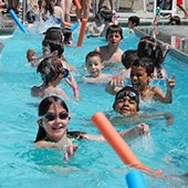 Children in the current channel at Thornton Park pool