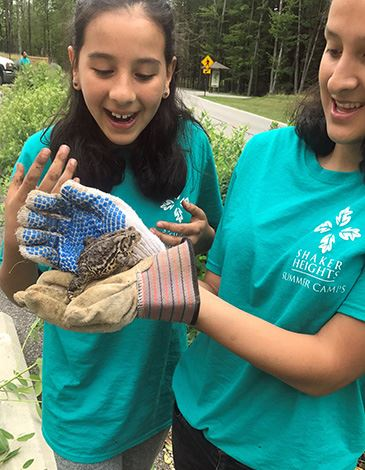 Girls at Shaker Heights summer camp holding a toad