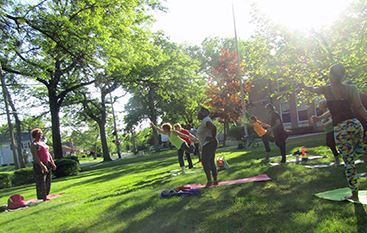 Residents doing yoga in the park in Shaker Heights, Ohio