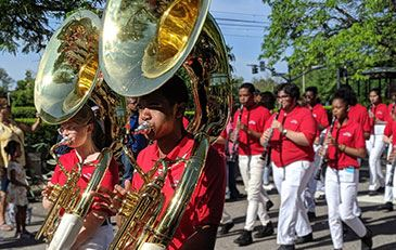 Shaker High students marching while playing the tuba in the Memorial Day parade.