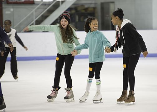 Three Girls Ice Skating