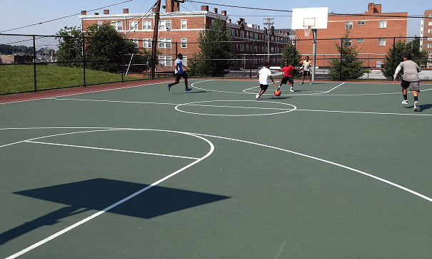 Kids Playing on Basketball Court